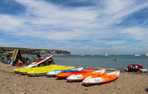 Kayaks and pedal on Swanage beach
