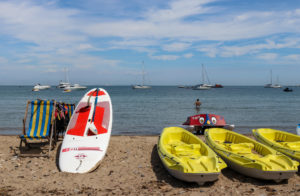 Paddle board and kayaks on Swanage beach