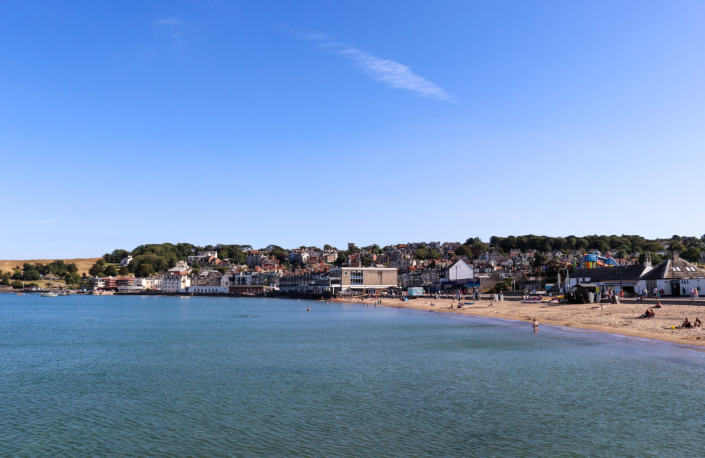 Swanage Beach and sea with The Mowlem in distance