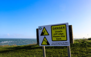 Cliff danger warning sign at the downs in Swanage