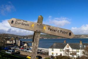 Wooden sign on the Downs showing the way to Durlston and Peveril Point