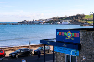 Ka's Funworld sign in front of Swanage Bay