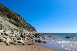 Stones and cliff at the northern end of Swanage Beach