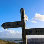 Walking and bridle path sign for Old Harry Rocks at the Swanage obelisk