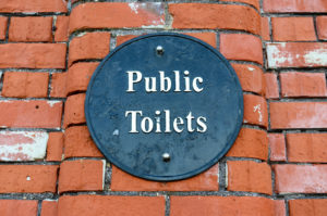 Swanage town public toilets sign on a brick wall