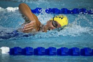 Man swimming in indoor swimming