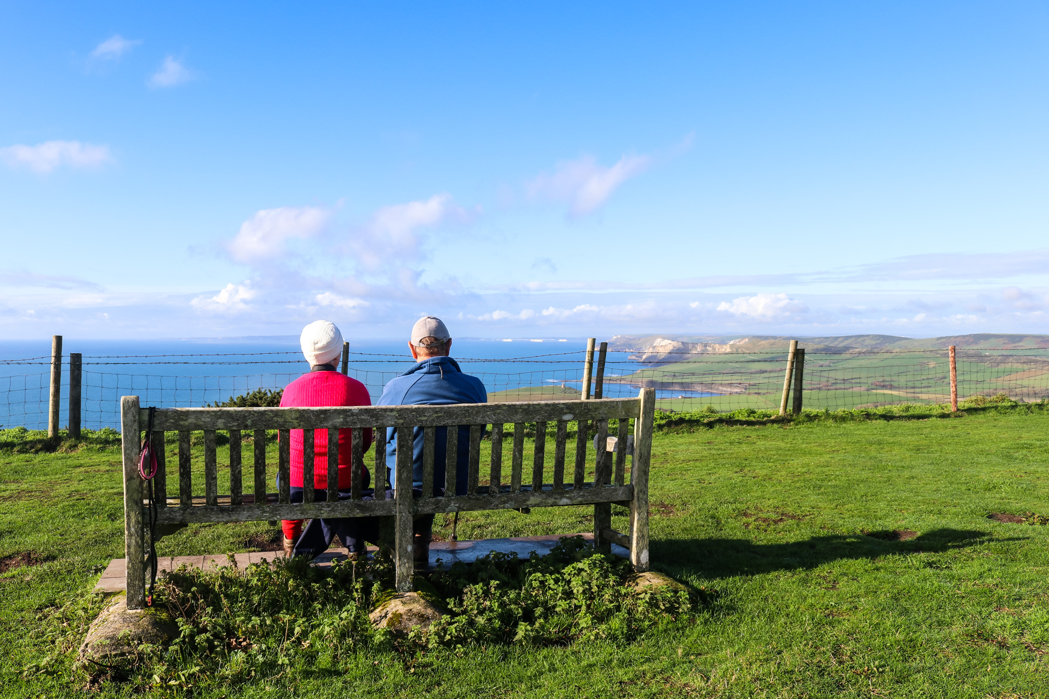 Swyre Head couple on bench looking at the view
