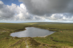 Flooded disused clay pit in Dartmoor National Park