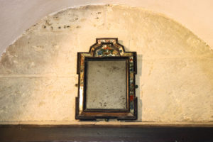 Mirror from the Halsewell shipwreck hanging in St Nicholas' Church, Worth Matravers