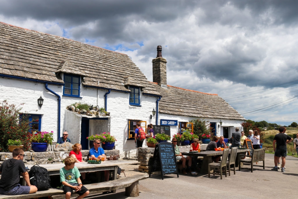People outside the Square and Compass pub in Worth Matravers