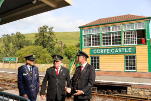 Corfe Castle railway station station volunteers chatting