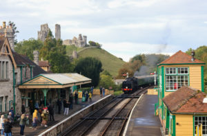 People on the platform as train comes in at Corfe Castle station