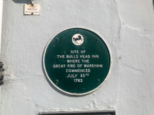 Plaque on a wall of South Street in Wareham commemorating the 'Great Fire of Wareham' in 1762