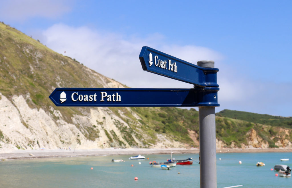 Lulworth Cove coast path signs