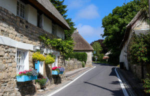 Thatched cottages with window boxes on street in West Lulworth