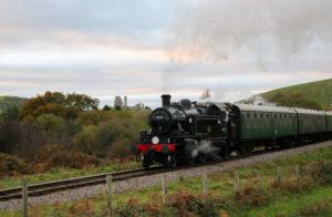 Steam train going past Corfe Castle