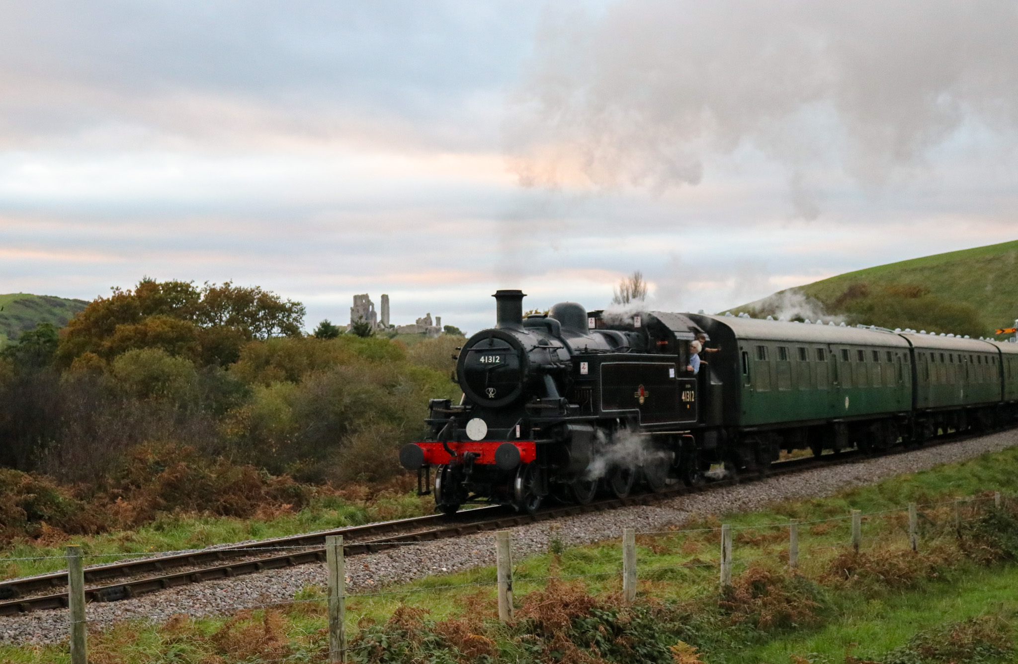 Steam train going past Corfe Castle