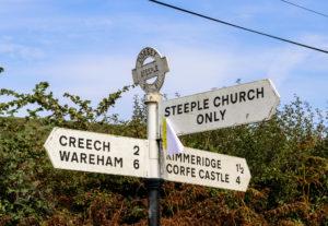 Road sign for Corfe, Kimmeridge, Steeple and Wareham