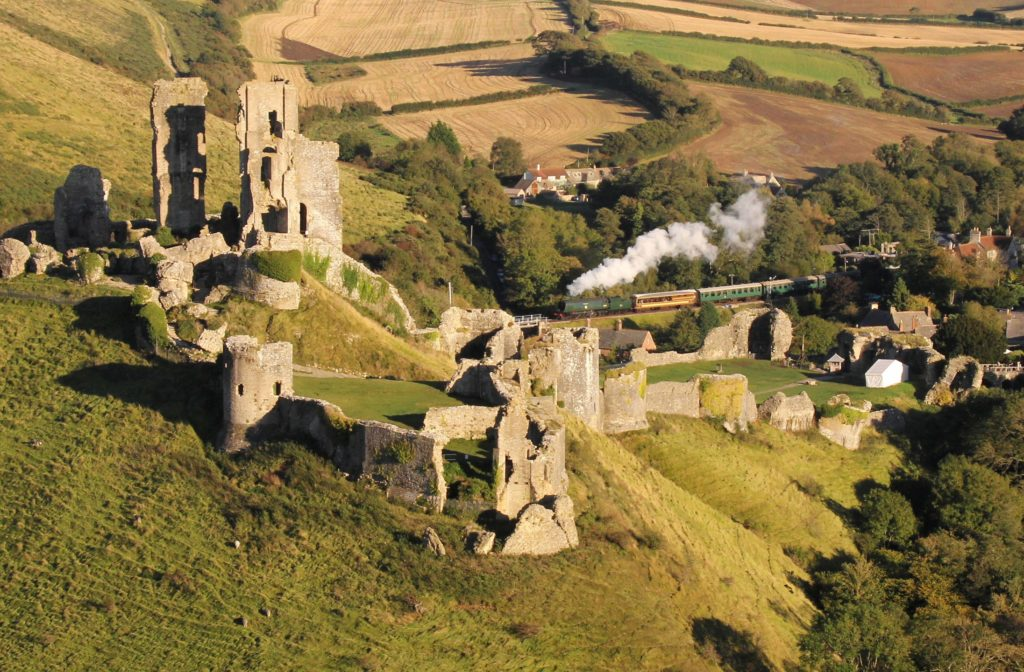 Arial view of Corfe Castle and Swanage steam train