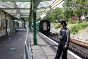 Swanage Railway staff member on platform at Swanage Station