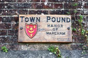 Wareham Town Pound sign on brick wall
