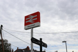 Sign for Wareham Station and bus stop walking route