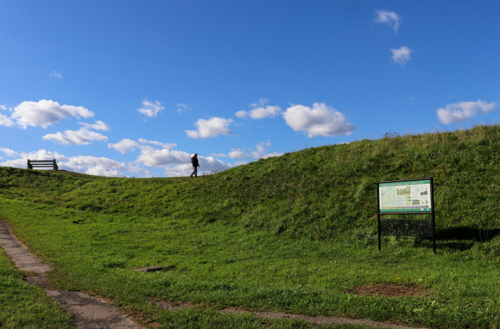 Person walking on top of the Wareham Walls