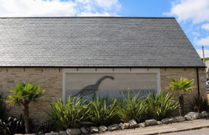 Dinosaur on side of the Etches Collection building in Kimmeridge