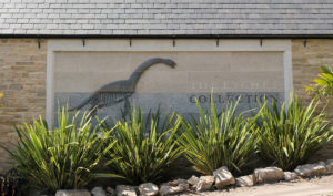 the Etches Collection museum sign with dinosaur