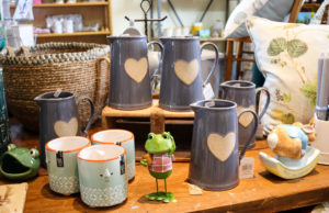 Cups and jugs shop display, East Lulworth