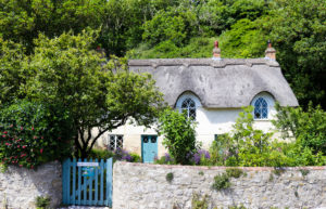 Thatched cottage with blue gate in West Lulworth