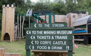 Norden station sign next to playground