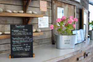 Seafood menu and flowers at Swanage restaurant