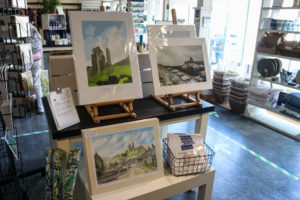 Artwork of Corfe Castle on display in the National Trust shop in the village