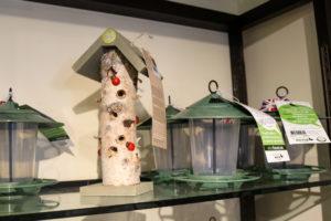 Bird feeders on a shelf in shop in Corfe Castle
