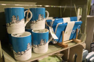 Blue and white Corfe Castle illustration on mugs and tea towels