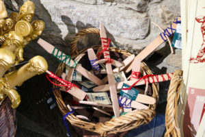 Basket of wooden toy daggers in Corfe Castle NT shop
