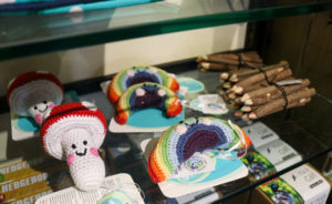 knitted mushroom and rainbow toy on shelf in Corfe Castle shop