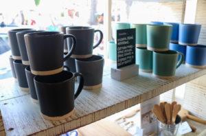 Mugs on shelf in the Corfe Castle National Trust shop