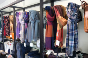 Scarves on display at Corfe Castle's National Trust shop