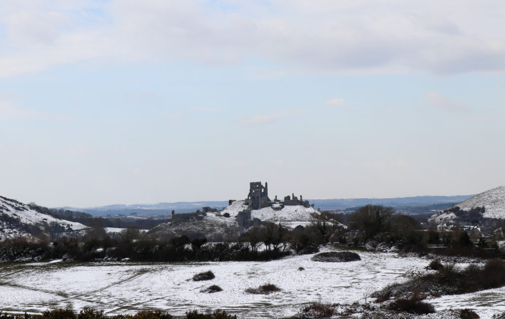 Corfe Castle in the snow view from common