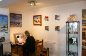 Artist at work in Wareham's Creative Gallery