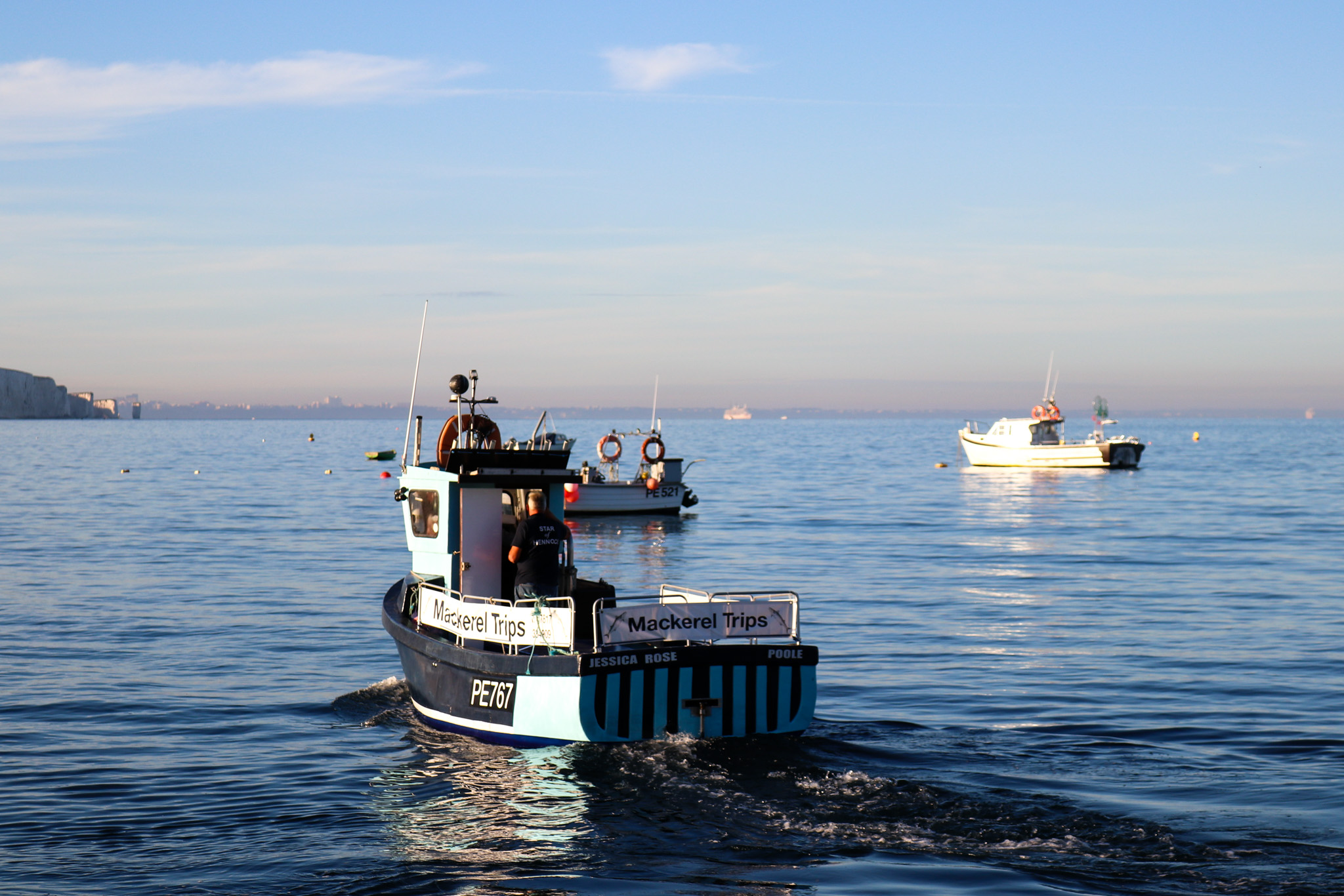 Mackerel boat going out at Swanage Bay