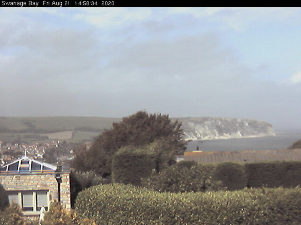 Webcam screenshot showing view across to Ballard Down