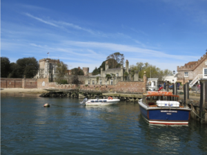 Boats in harbour in front of Brownsea Castle