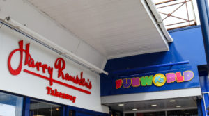 Signage for Harry Ramsden's takeaway and K's Funworld in Swanage