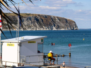 Lifeguard and safe safe swimming area at Swanage beach