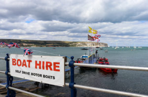 Self-drive boat hire sign in Swanage