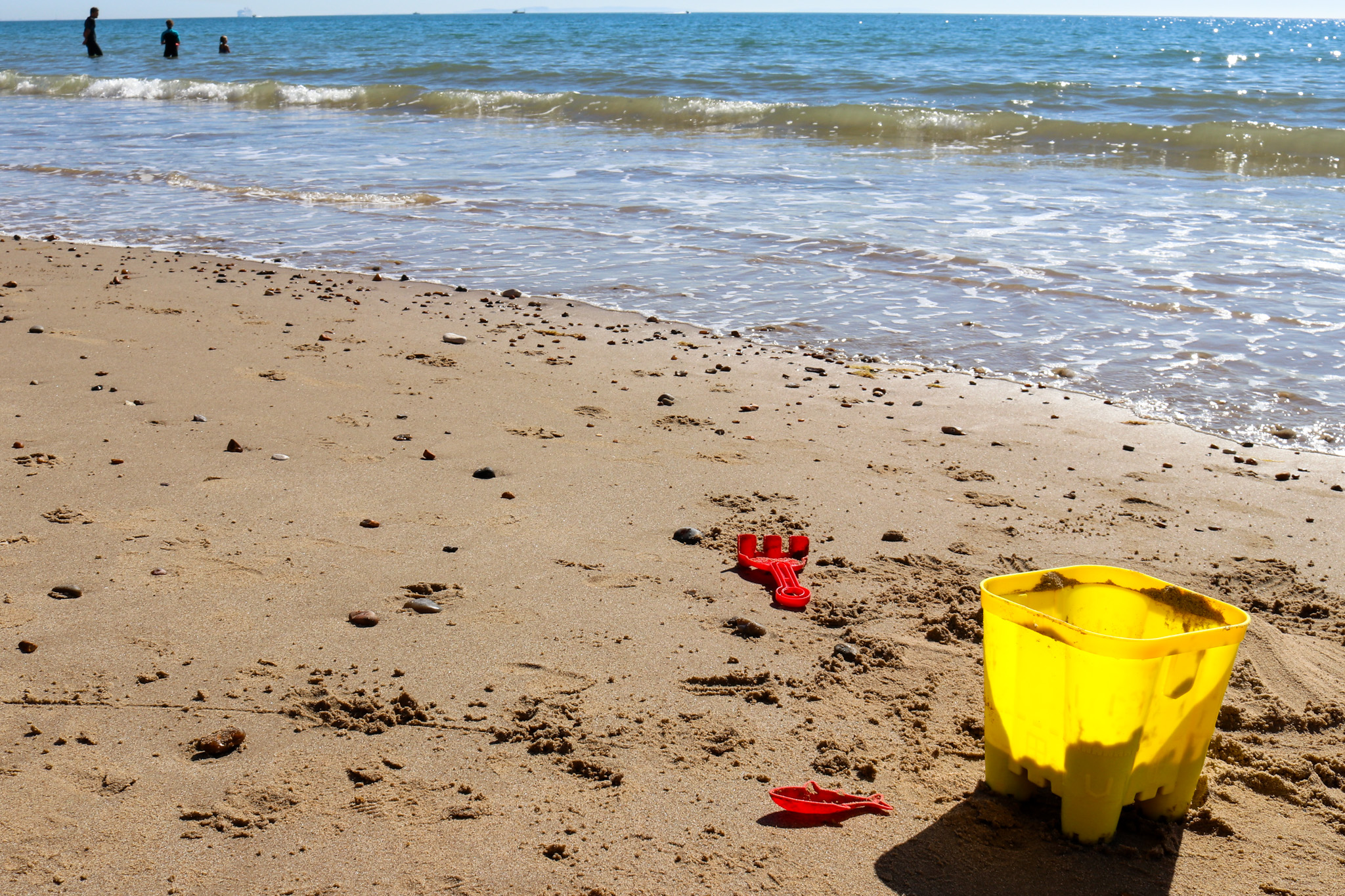 Yellow bucket and red Spade at North Beach in Swanage
