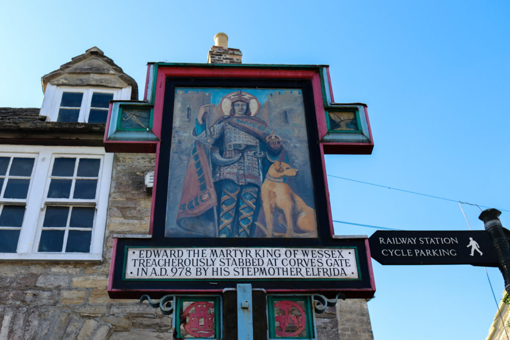 Sign showing Edward the Martyr in Corfe Castle village square